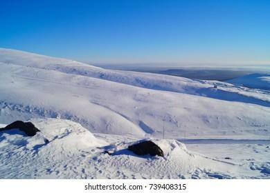 View of the snow-covered slopes of Mount Aikuainwichorr, Kirovsk, Murmansk region
