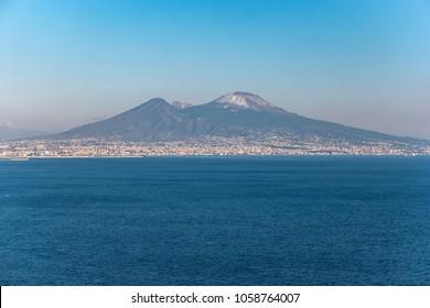 View of snow-covered Volcano Vesuvius from Posillipo Hill, Naples, Campania, Italy