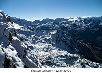 View of a snowy mountain range from top