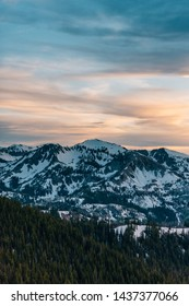 View of snowy mountains in the Wasatch Range of the Rocky Mountains at sunset, from Guardman's Pass, near Park City, Utah