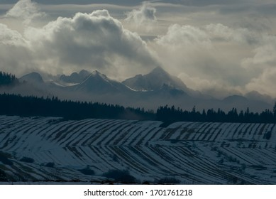 view of the snowy Tatra mountains from the Podhale region