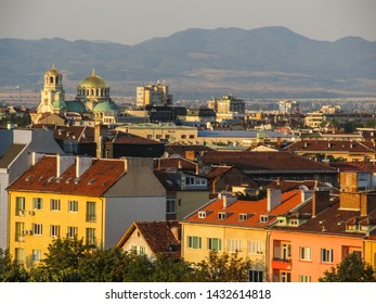 A view of Sofia's cityscape from above at sunset with Vitosha mountain in the background (Sofia, Bulgaria)