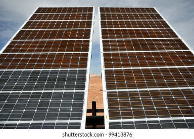 View of solar panels against cloudy sky