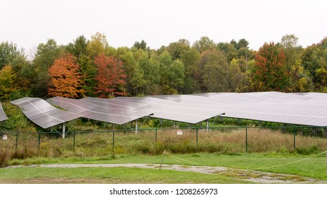 View of solar panels outside a factory in Vt. on a cloudy Autumn day.