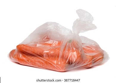 View of some carrots inside a plastic bag isolated on a white background.