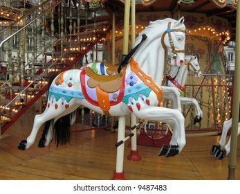 a view of some colored carousel horses