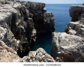 View of some little cliffs in Lokrum island in a sunny summer day. Dubrovnik, Croatia