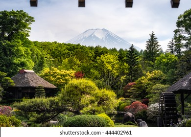 View from somewhere near Oshino Hakkai, Japan with Mt. Fuji in the background and roof on the foreground
