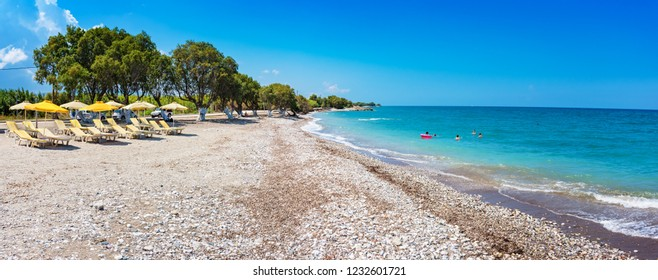 View of Soroni beach with umbrellas and sun beds - PANORAMA (Rhodes, Greece)