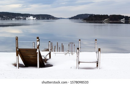 View south from common play- and recreation area in Melsomvik, Norway, at wintertime.