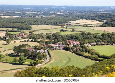 View of the South Downs way from the hill, East Sussex, England: fields and the houses