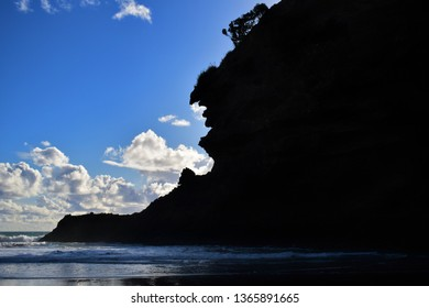 View of south side of Kaiwhare Point head at Piha