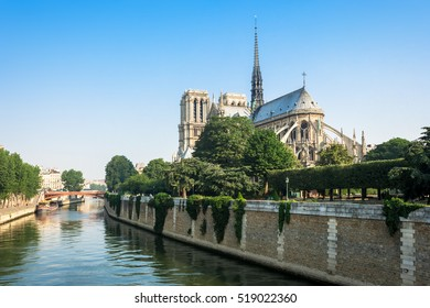 View of southern facade of Notre-Dame de Paris from the Seine river. Notre-Dame cathedral  is a medieval catholic cathedral and finest example of french gothic architecture. Paris, France.