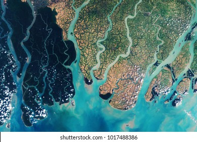 View from space on the Sundarbans, a vast forest in the coastal region of the Bay of Bengal - Modified elements of this image furnished by ESA