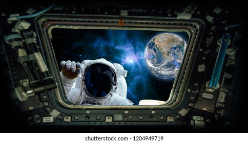"View from a spaceship window with an astronaut knocking and the earth ""Elements of this image furnished by NASA"""