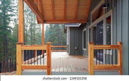 View of a spacious walkout deck with wooden railing and nice view