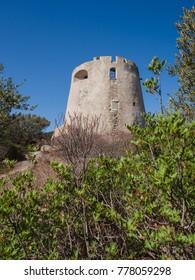 A view of the Spanish watchtower of Porto Giunco, Villasimius, Sardinia, Italy.