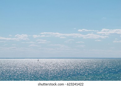 view of sparkle sea water have sailboat on blue sky at Sandringham beach, Australia
