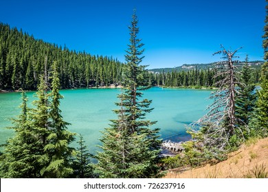 View of Sparks Lake on the Cascade Lakes Scenic Byway in Bend Oregon in Deschutes County. The lake has a natural teal green blue color from glacial sediments