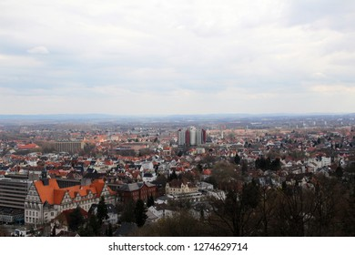 view from the sparrenburg on the houses and buildings in bielefeld germany photographed during a sightseeing tour at a sunny day