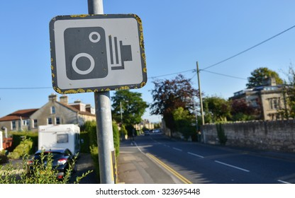View of a Speed Camera Warning Sign on a City Street