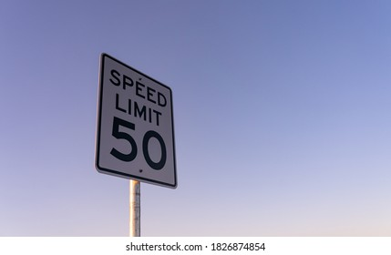 View of Speed Limit Sign on the Side of Road During Early Morning
