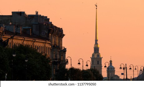 View of spire of Peter and Paut fortress on sunset. Pink sky anf gold spire. Saint Petersburg, Russia