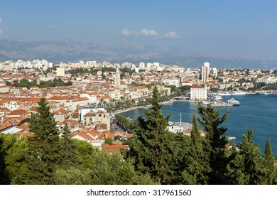 View of Split's harbour, historic old town and beyond from above in Croatia.