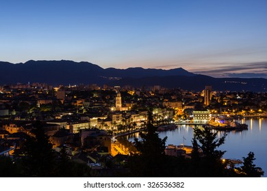 View of Split's historic Old Town and beyond from above in Croatia at night. Copy space.