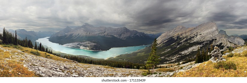 View of Spray Lake while hiking down the slope of Windtower Peak Summit, Near Canmore, Alberta, Canada. Mount Rimwall can be seen on the far right.