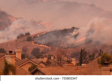 A view of the spreading flames from the Canyon Fire 2 wildfire in Anaheim Hills and the City of Orange