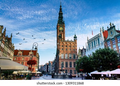 View of square and street named Long Lane (Długi Targ) with historic Gdańsk Main Town Hall (Ratusz). The Ratusz construction started in 1346. It's located in the Gdańsk Main City. Poland (Polska).