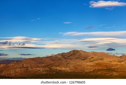 View from Srd mountain in Dubrovnik, Croatia at beautiful mountain Ivanica of Bosnia and Herzegovina with sunset and cloudy blue sky