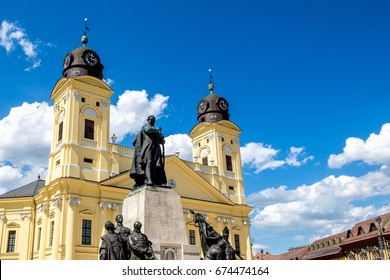 View of St. Anne's Cathedral with the statue of the iconic 19.c. historical figure Lajos Kossuth standing on the square named after him. City of Debrecen, Hungary, Europe