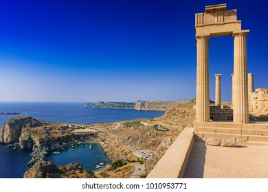 View of St. Paul´s bay and ancient temple of goddess Athena on acropolis of Lindos (Rhodes, Greece)