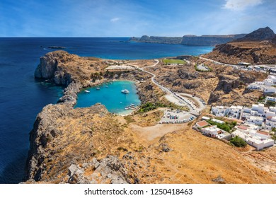 View of St. Paul´s bay, Lindos village and Mediterranean Sea from acropolis of Lindos (Rhodes, Greece)