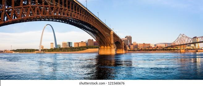 A view of St Louis and The Gateway Arch seen through Eads Bridge