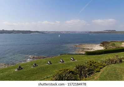 View from St Mawes in Cornwall across the Carrick Roads on the River Fal looking towards Falmouth with Tudor canons in the foreground