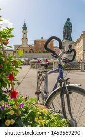 View of St. Michaelskirche and Mozart Statue in Residenzplatz, Salzburg, Austria, Europe 1-6-2019