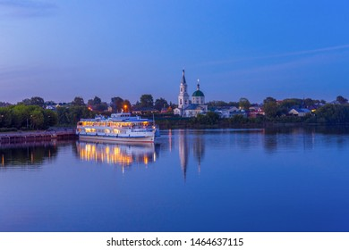 View to St. Catherine's monastery with cruise ship on Volga river in summer evening. Beautiful night Russian cityscape with cruise liner on water. Travel blog concept. Tver, Russia