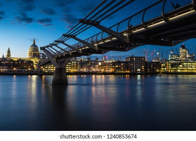 View of St Pauls cathedral and Millenium bridge at sunset from the south Bank of the River Thames  London.