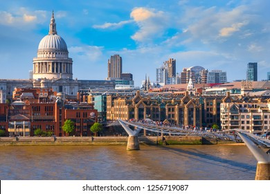 View of St Paul's Cathedral with people crossing the Millenium Bridge (London Millennium Footbridge)