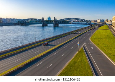 View of St. Petersburg on a Sunny summer day. Rivers Of St. Petersburg. Bridges Of St. Petersburg. Bolsheokhtinsky bridge. View Smolny Cathedral in the span of the bridge of Peter the Great.