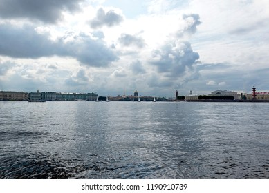 view of St. Petersburg, yachts with sails, Neva river, Admiralty spire, Rostral columns, exchange building, dome of St. Isaac's Cathedral, , winter Palace, Russia, sky with clouds,  sky over St. Peter