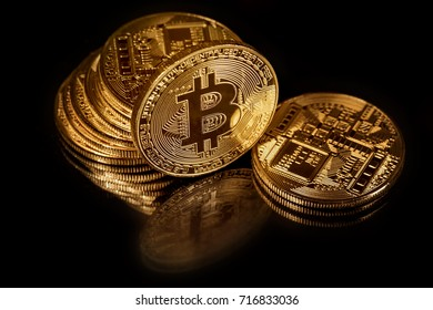 View of a stack of bitcoins on black background - blockchain and cyber currency concept