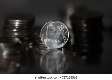 View of stacks of russian rouble coins of different values on black background