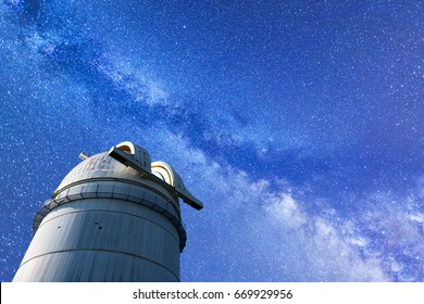 A view of the stars of the Milky Way during the summer. High resolution composite image with an astronomical observatory in the foreground.