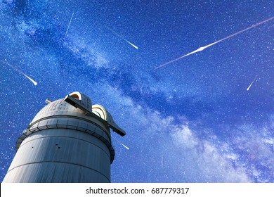 A view of the stars of the Milky Way. Night sky nature summer landscape. Meteor Shower. Falling stars. Comets. Perseid Meteor Shower in 2017. Astronomical observatory in the foreground.