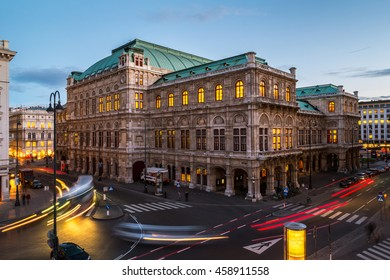 View of State Opera in Vienna, Austria during the night. Bright blue sky, car light trails