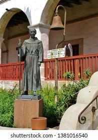 View of a statue and bell in Santa Barbara California dedicated to Spanish missionary Junipero Serra